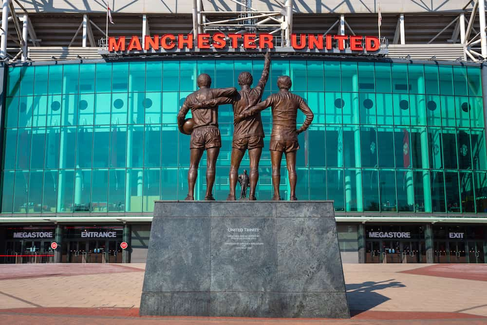 MANCHESTER, UK - The United Trinity bronze sculpture which composed with George Best, Denis Law and Sir Bobby Charlton in front of Old Trafford stadium