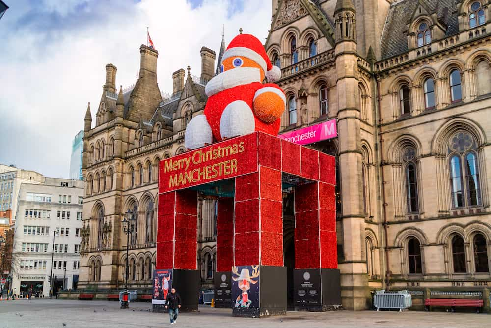 MANCHESTER, UK - Historic Manchester Town Hall Designed by architect Alfred Waterhouse decorated for festive season with a figure of Father Christmas. Manchester