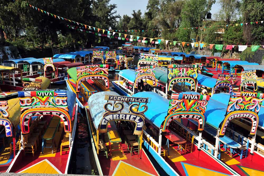 Colorful Mexican gondolas at Xochimilcos Floating Gardens in Mexico City, Mexico