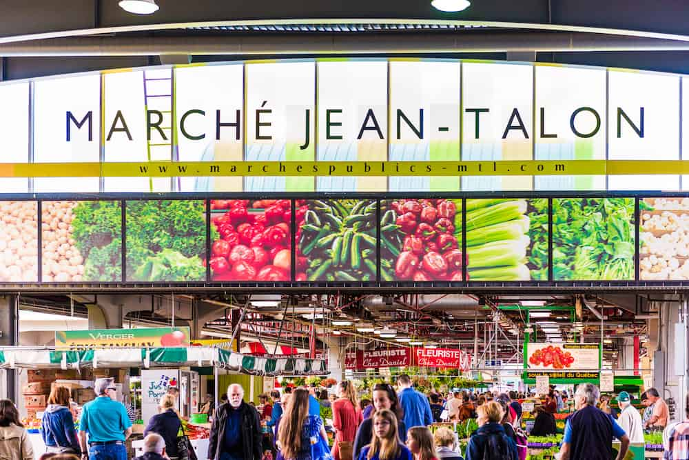 Montreal Canada - : Jean Talon market sign and entrance with people in Little Italy neighborhood in city in Quebec region