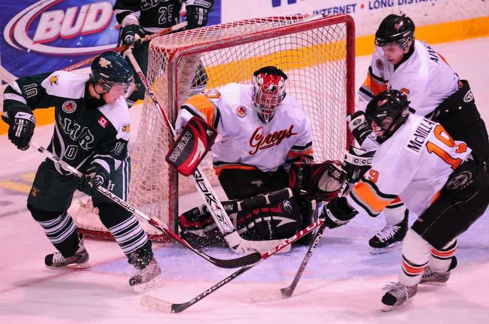 Scramble at the net. Owen Sound Greys vs Elmira Sugar Kings Ontario Hockey League game. Owen Sound Ontario Canada.