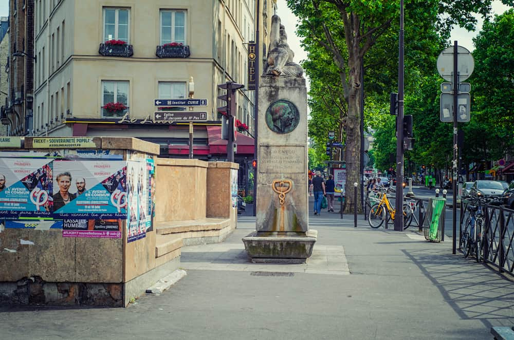 Paris, France - Monument of Caventou and Pelletier is located at boulevard Saint Michel. In the left side there are campaign posters Legislative elections
