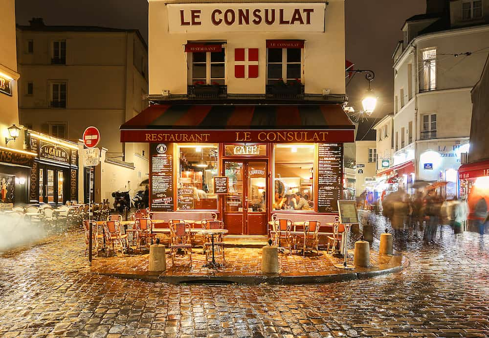 PARIS , France- View of typical paris cafe in Paris. Montmartre area is among most popular destinations in Paris, Le Consulat is a typical cafe.