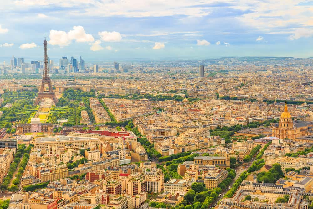 Tour Eiffel and national residence of the Invalids from Observatory Deck of Tour Montparnasse. Aerial view of Paris skyline and cityscape. Top of the Tour Montparnasse tower of Paris city in France.