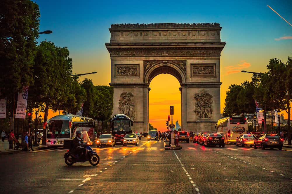 Paris, France -: square at Champs Elysees street and center of Place Charles de Gaulle with Arch of triumph at twilight with traffic street. Arc de Triomphe at blue hour in Paris.