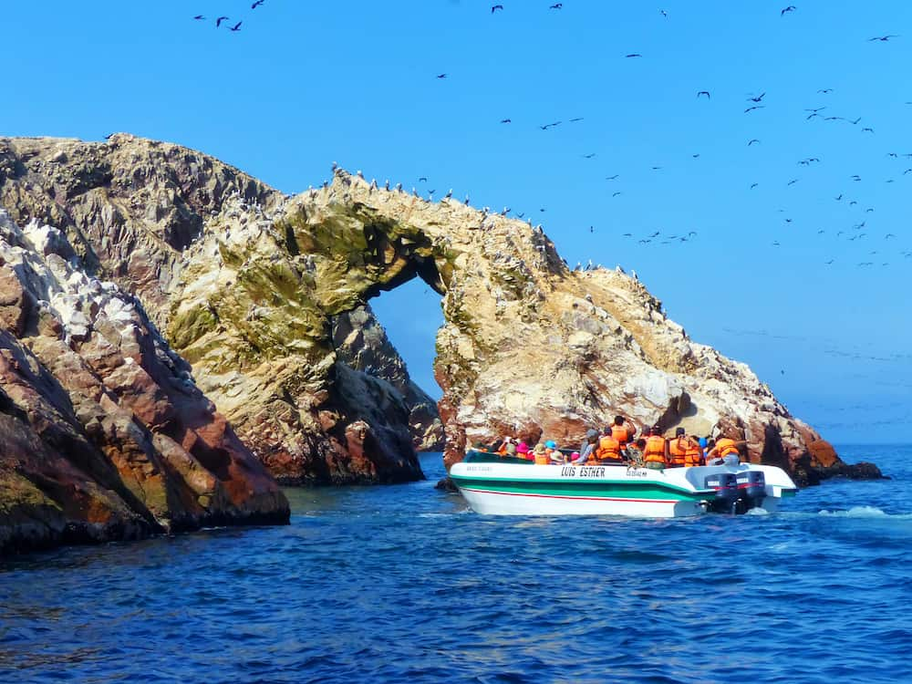 PARACAS, PERU- Unidentified people visit Ballestas Islands Reserve in Pisco Bay, Peru. Ballestas islands are an important sanctuary for marine fauna