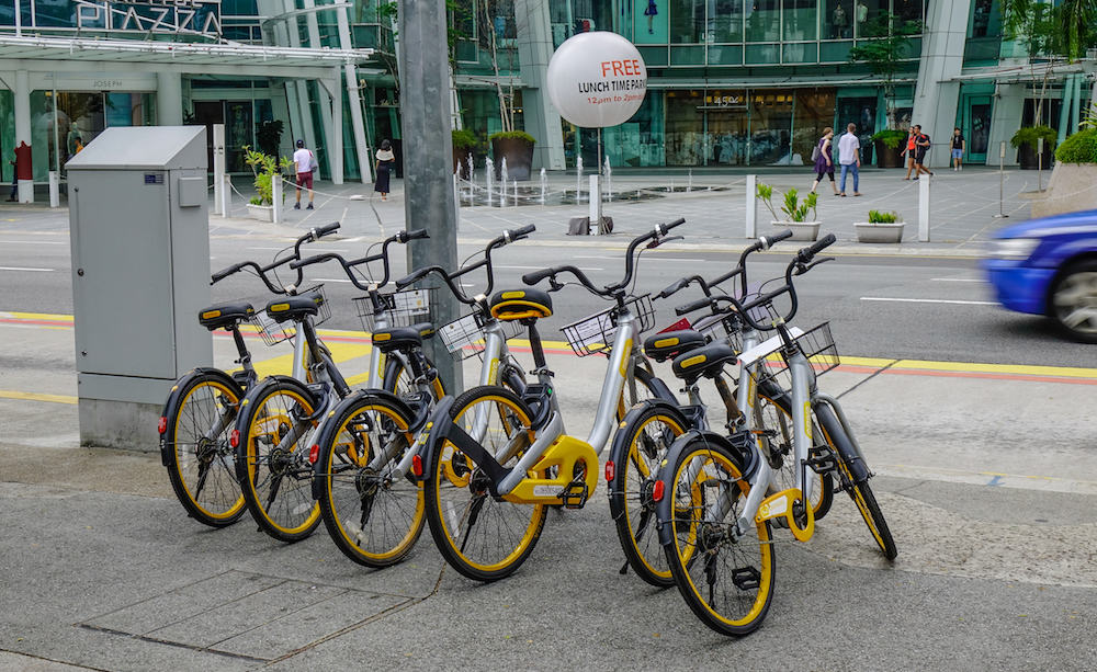 Singapore -. Bicycle Rental on street in Singapore. Singapore is a global commerce, finance and transport hub.
