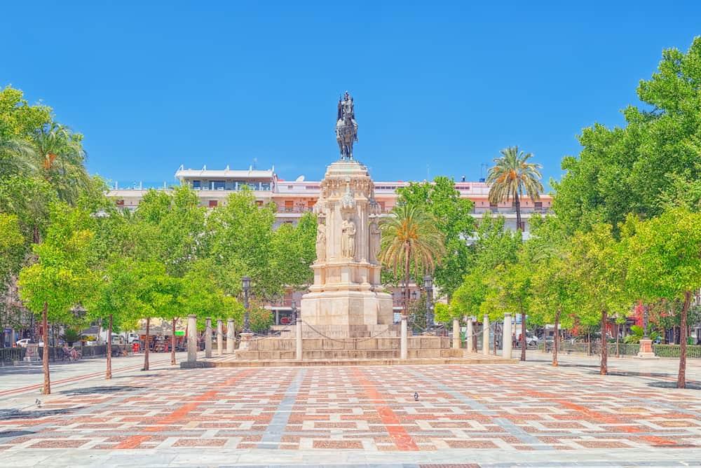 New Square (Plaza Nueva) and monument of Fernando III The Saint (Fernando III El Santo) in Seville Spain.