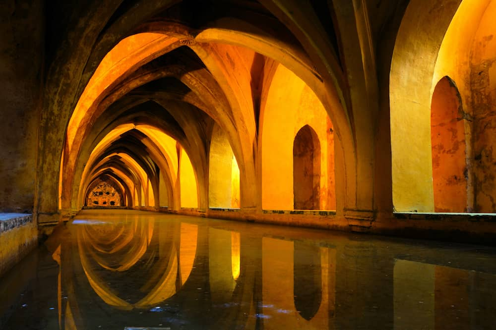 Royal baths at the Alcazar of Sevilla Spain with reflections