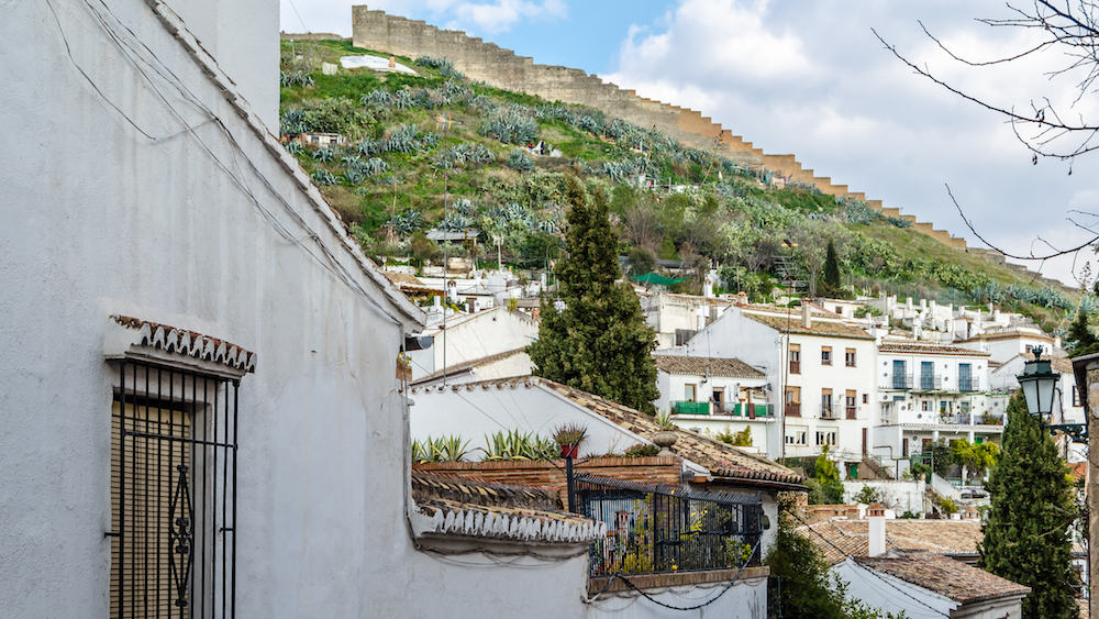 GRANADA, SPAIN - Traditional houses in the picturesque neighborhood of Sacromonte in Granada, Andalusia, southern Spain
