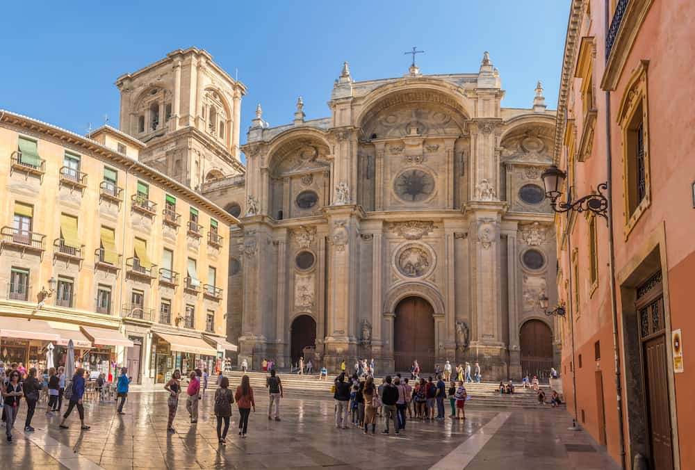 GRANADA,SPAIN - View at the South portal Cathedral of Granada at Pasiegas place. Granada is located at the foot of the Sierra Nevada mountains.