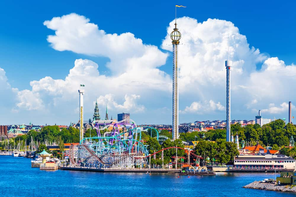 Scenic summer view of amusement park Grona Lund with attractions and rides on Djurgarden island in Stockholm Sweden