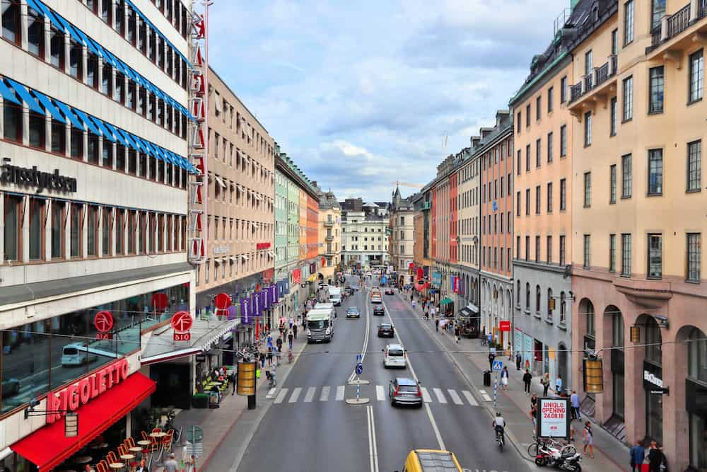 STOCKHOLM, SWEDEN - People visit Kungsgatan street in Norrmalm district, Stockholm, Sweden. Stockholm is the capital city and most populous area in Sweden.