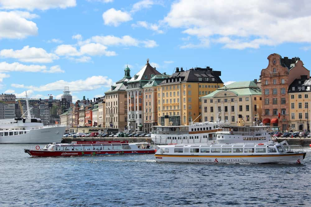 Stockholm, Sweden-Swedish passenger ship for tourist. attraction for a sightseeing on the background of old town port with hotels and old buildings. Sunny summer weather. Blue sky.