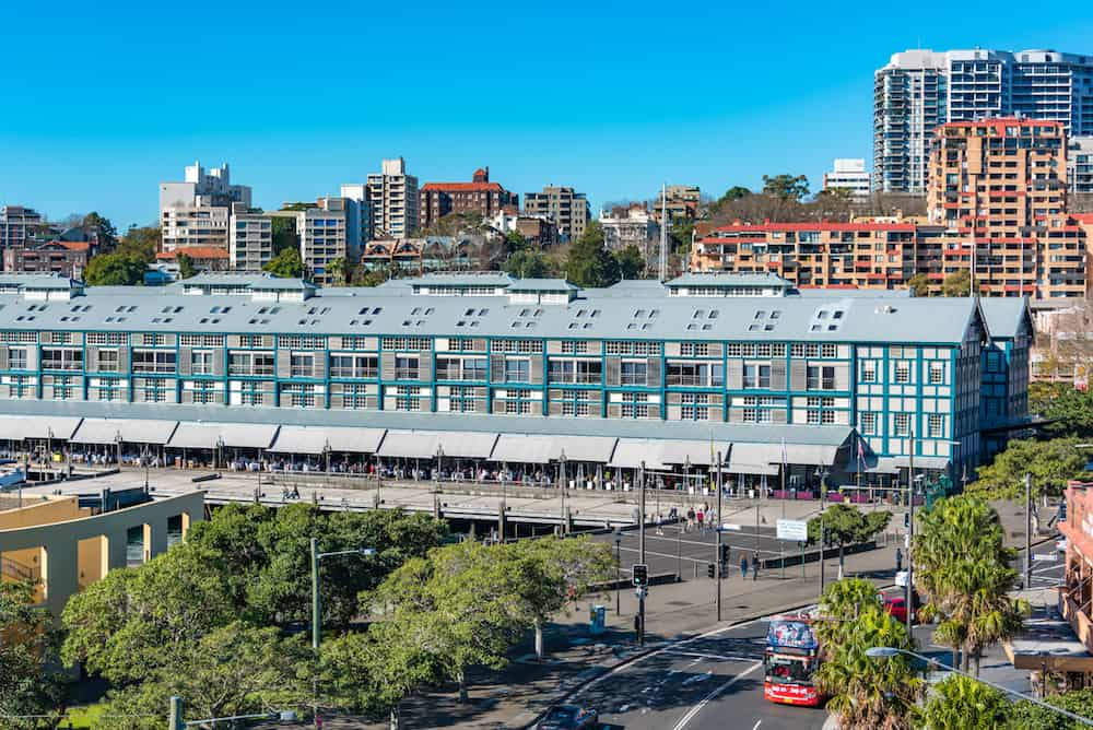 Sydney Australia - : Woolloomooloo historic wharf with restaurants and hotel. Woolloomooloo district cityscape on sunny day