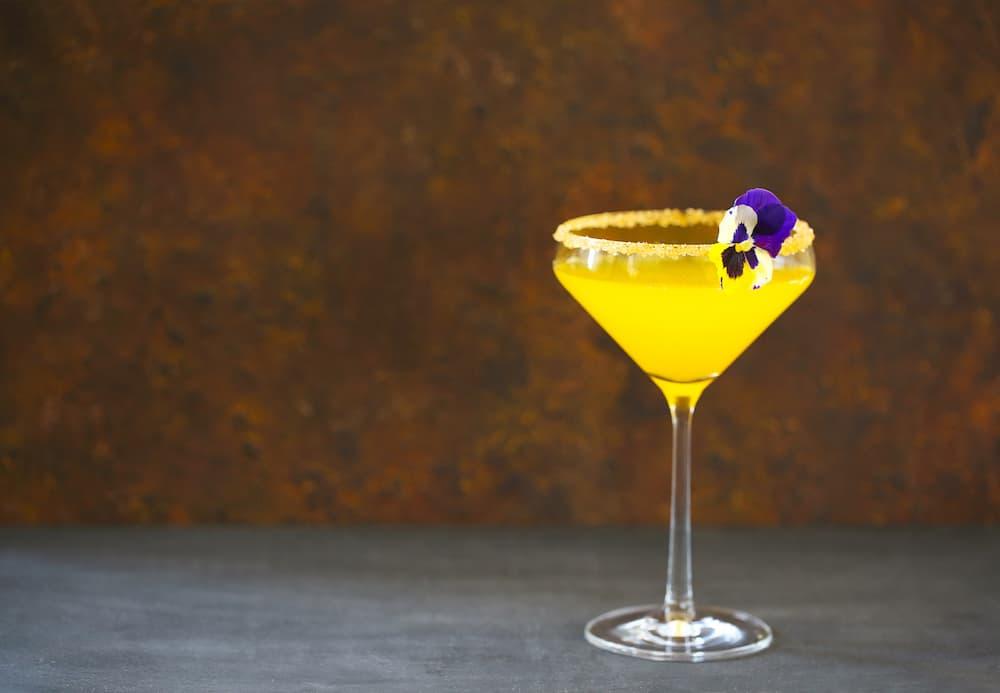 Agua de Valencia from fresh orange in glass on table
