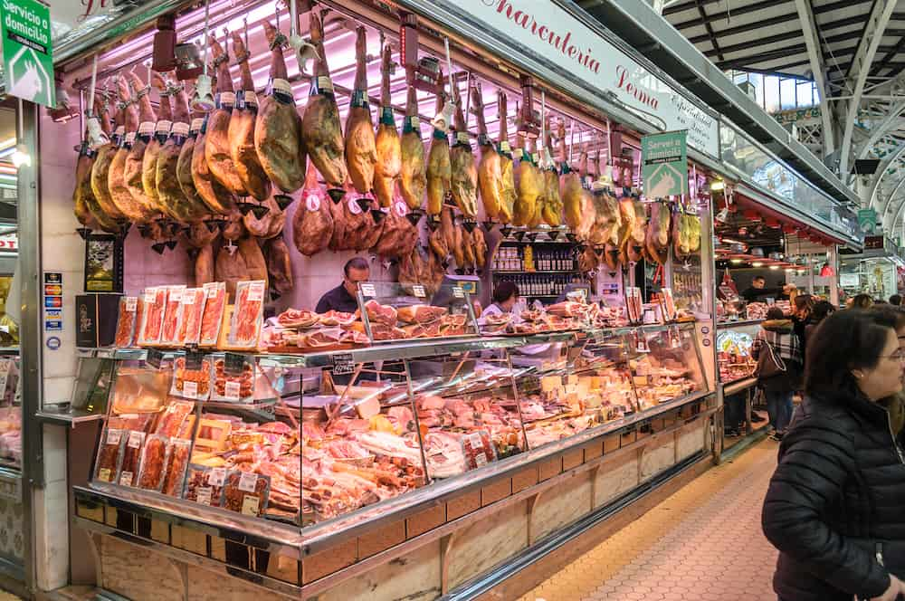 Valencia, Spain - Hams hanging at the Central Market of Valencia, Spain