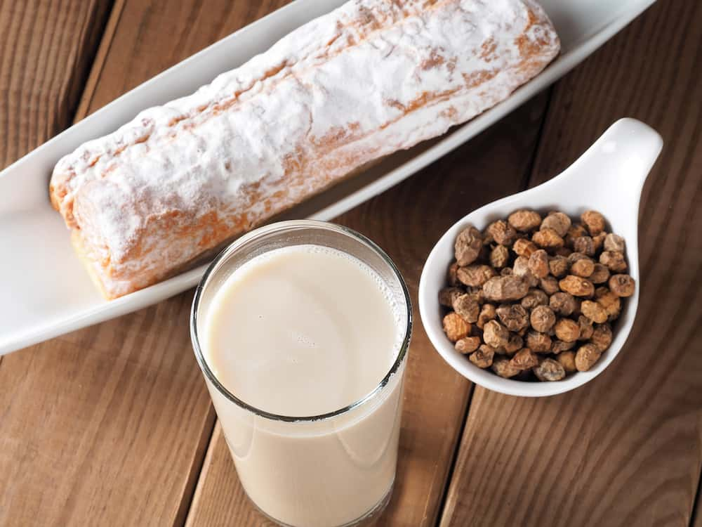 HORCHATA Horchata is a drink, made with the juice of tigernuts and sugar. Native from Valencia - Spain, it is a refreshing drink, often accompanied with long thin buns called fartons.