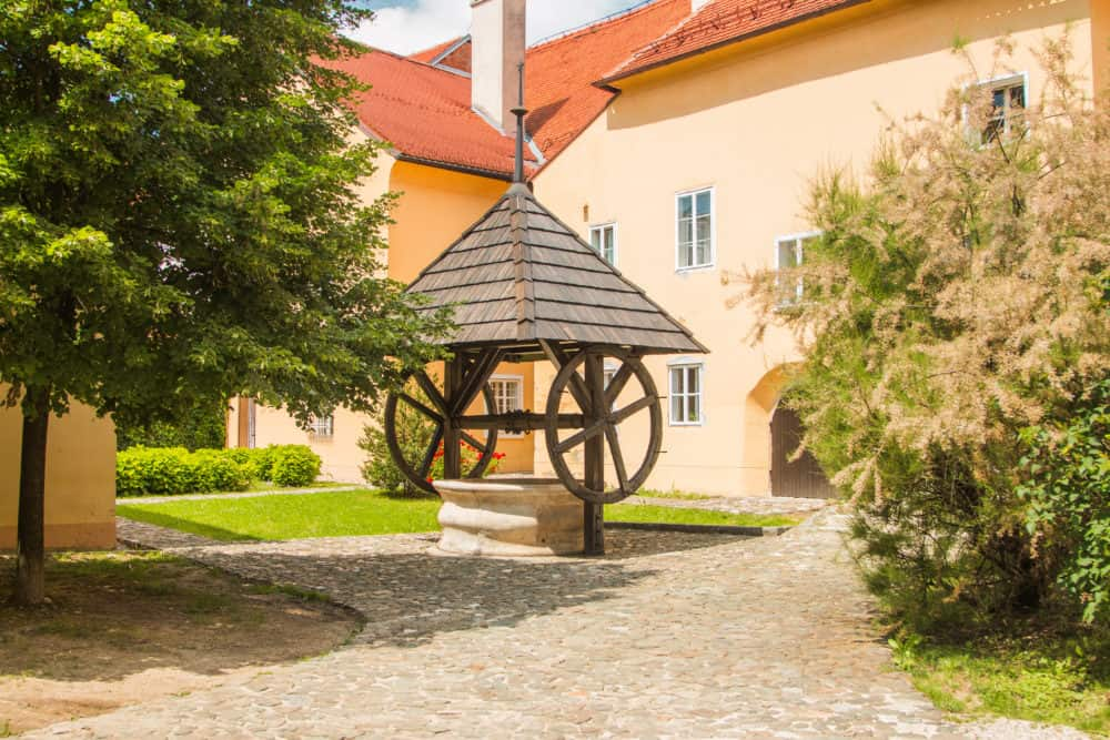 Zagreb, Croatia - Old traditional water well on Upper town in Zagreb, Croatia, urban landscape
