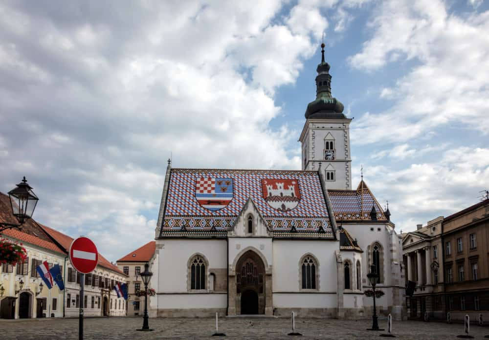The Church of St. Mark, located in St. Mark's Square in Zagreb, Croatia, originated in the 13th century, reconstructed in the 14th century, featured the Zagreb Coat of arms on the roof.