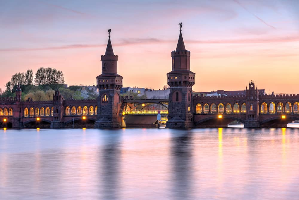 The lovely Oberbaumbruecke across the river Spree in Berlin at sunset