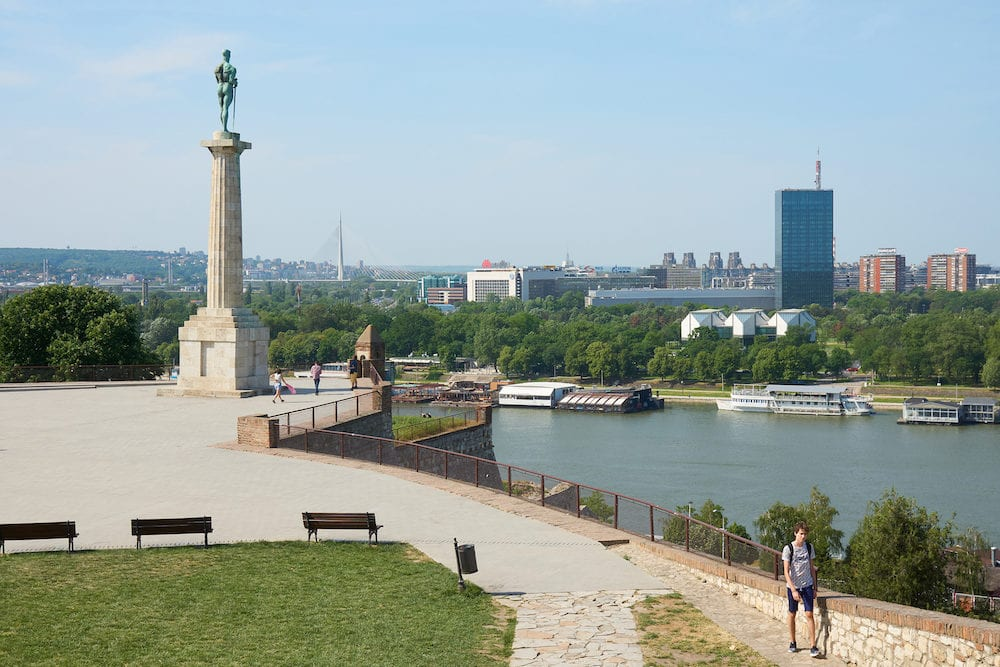 Belgrade, Serbia -Morning view on Sava river and Belgrade from Belgrade fortress. Pobednik (The Victor) monument is on the left. Some tourists walking in fortress.