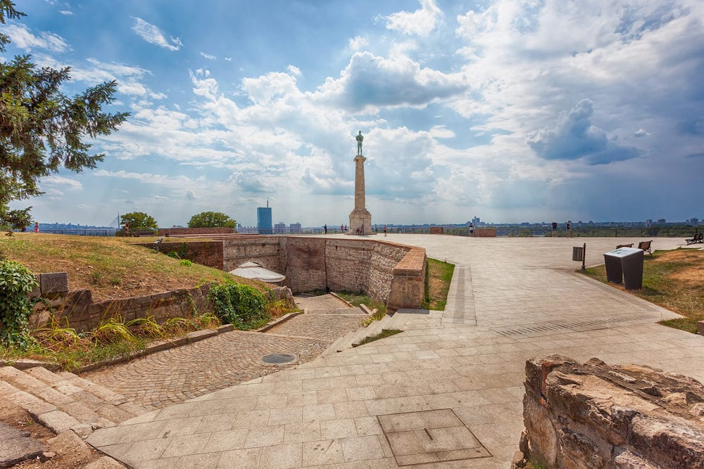 Belgrade, Serbia, Tourists visiting Victor monument, known as Pobednik, standing pristine on Kalemegdan, Belgrade historic fortress