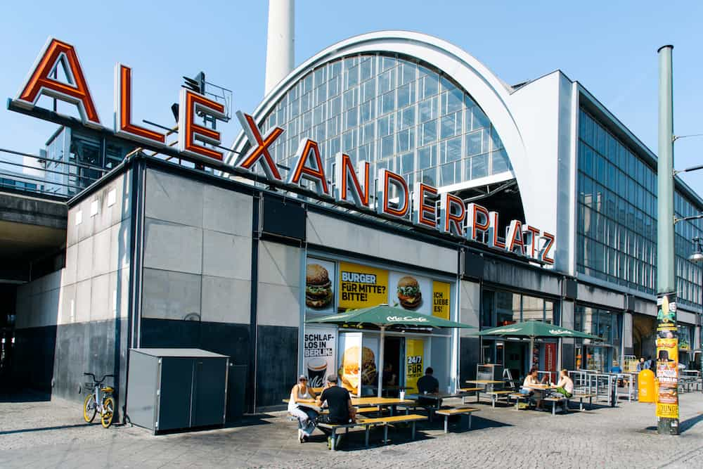 BERLIN, GERMANY - A view of the Alexanderplatz station in Berlin, Germany, with the structure of the Berliner Fernsehturm, the popular television tower, in the background