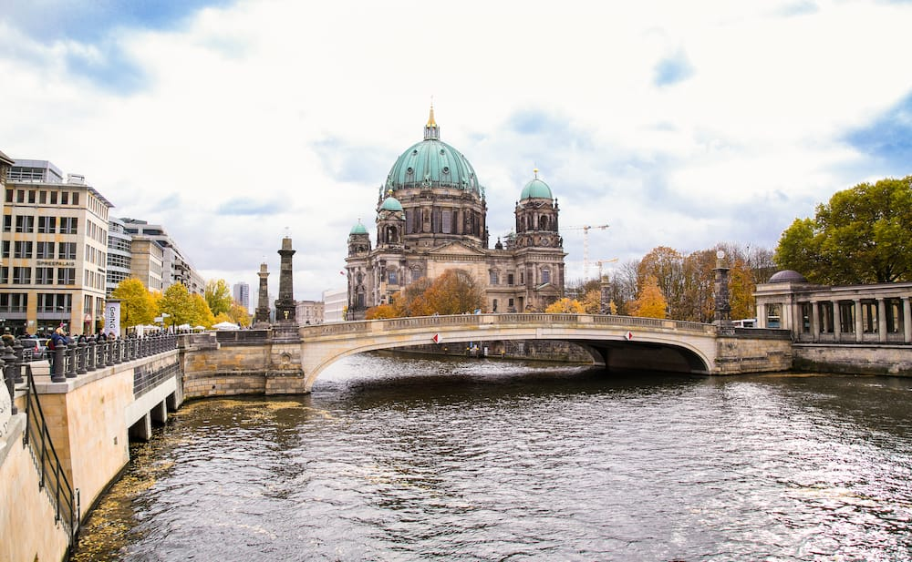 BERLIN, GERMANY-Beautiful view of Berliner Dom (Berlin Cathedral) at famous Museumsinsel (Museum Island) with excursion boat on Spree river in beautiful Berlin Germany..