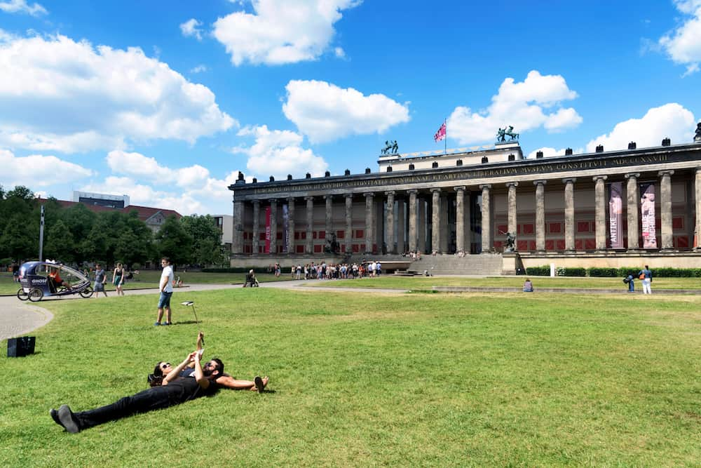 BERLIN, GERMANY - People at the Lustgarten park in the Museum Island, in the Mitte district of Berlin, Germany, in front of the Altes Museum, the Old Museum