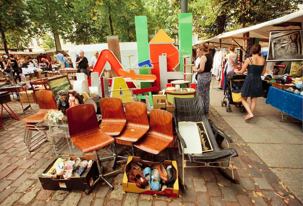 BERLIN, GERMANY -: Retro stuff furniture and utensils on sale of popular flea market. Urban area of Berlin comprised 4 mill. people 7th most populous in EU