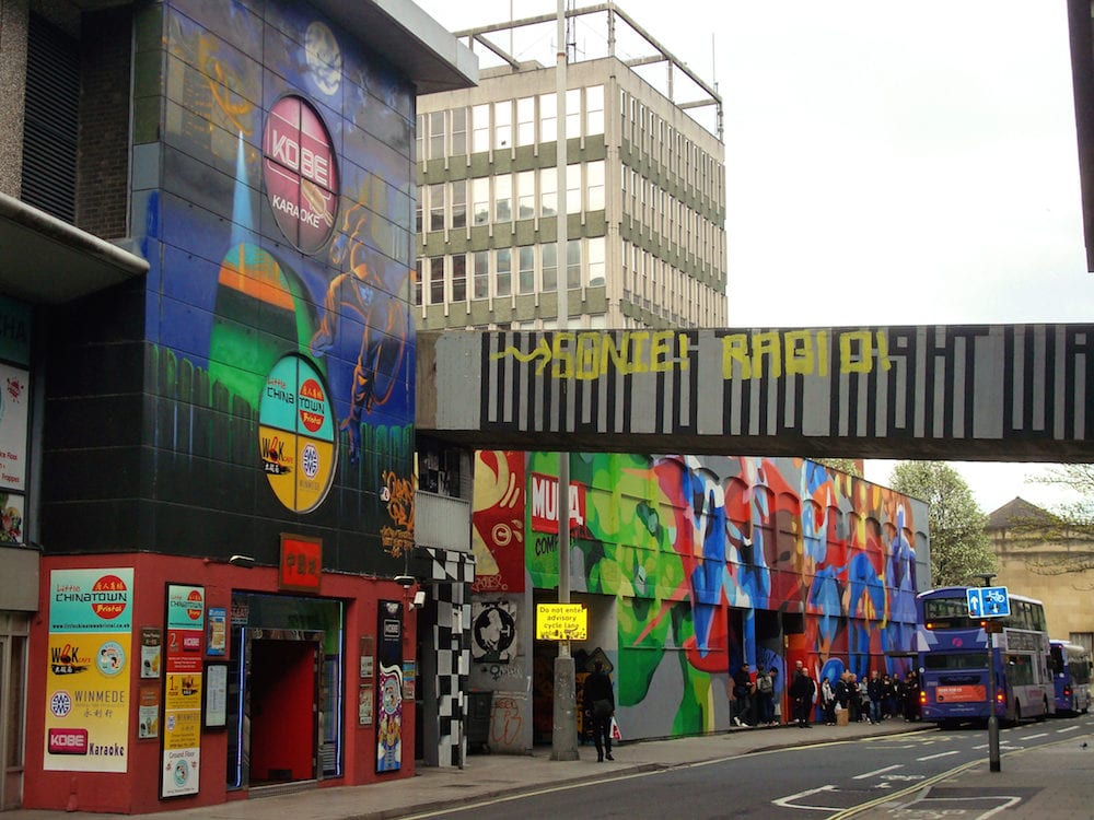 Bristol Uk - Artwork bellow an office block in Nelson Street and covering a chinese restaurant in central Bristol. Part of the See No Evil graffiti project in Bristol Britain's largest art project in 2011.