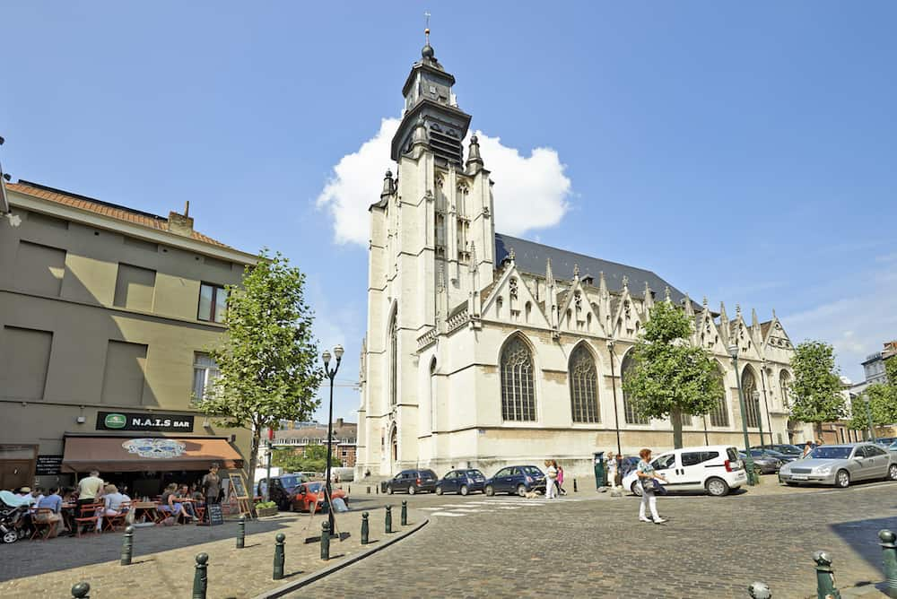 BRUSSELS BELGIUM - : Church Notre-Dame de la Chapelle on a sunny sunday in Brussels Belgium. People walking and resting this peacefull sunday.