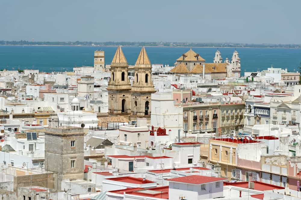 Aerial view of Cadiz from Torre Tavira, Andalucia, Spain, an ancient port city, built on a strip of land surrounded by the sea with more than 100 watchtowers, used for spotting ships.