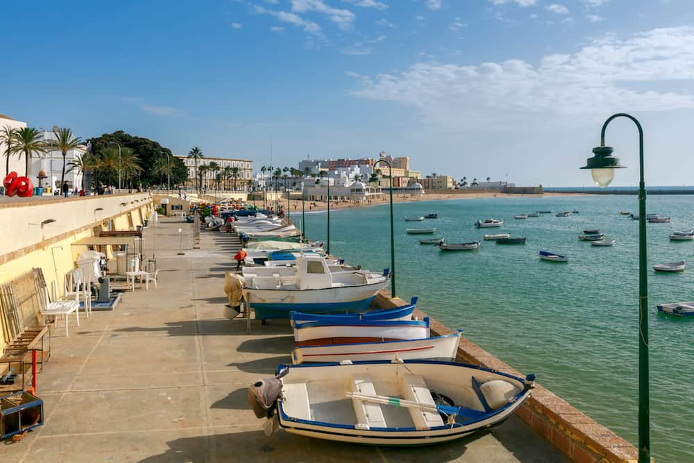 Colourful fishing boats on the waterfront and in the Bay of Cadiz. Spain. Andalusia.