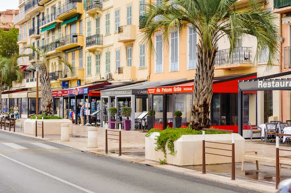 CANNES FRANCE - : Promenade de la Croisette in Cannes. Cannes hosts the annual Cannes Film festival from 1949
