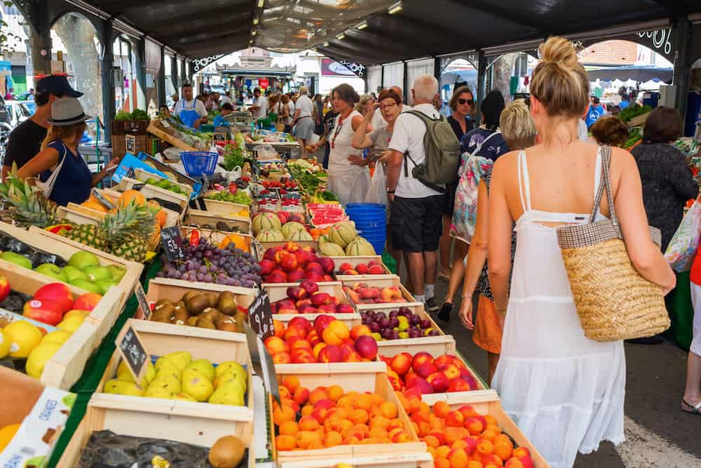 Cannes France - : Provencal market in Cannes with unidentified people. Cannes is well known for its association with the rich and famous and the Cannes Film Festival