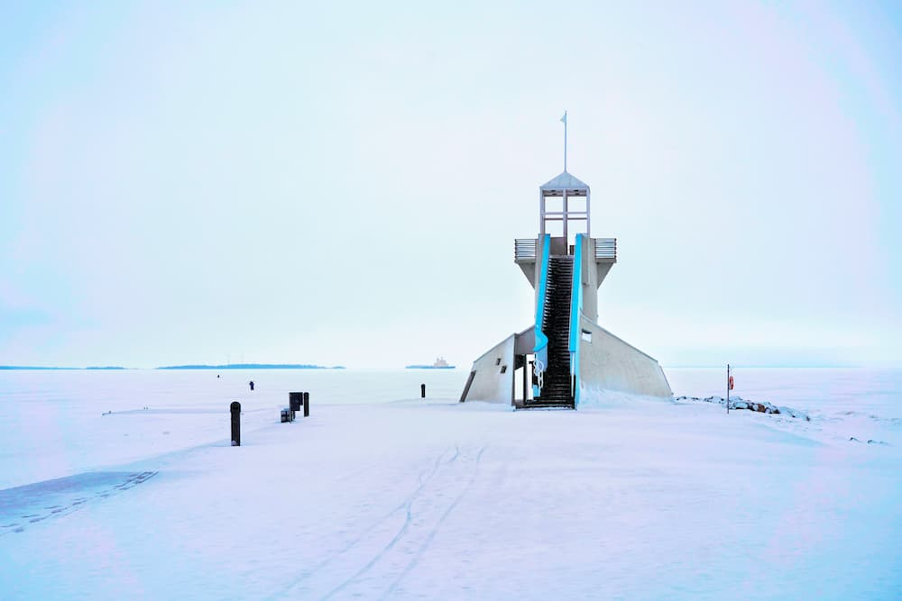 Lighthouse with staircase at the Baltic Sea in winter Oulu Lapland Finland.