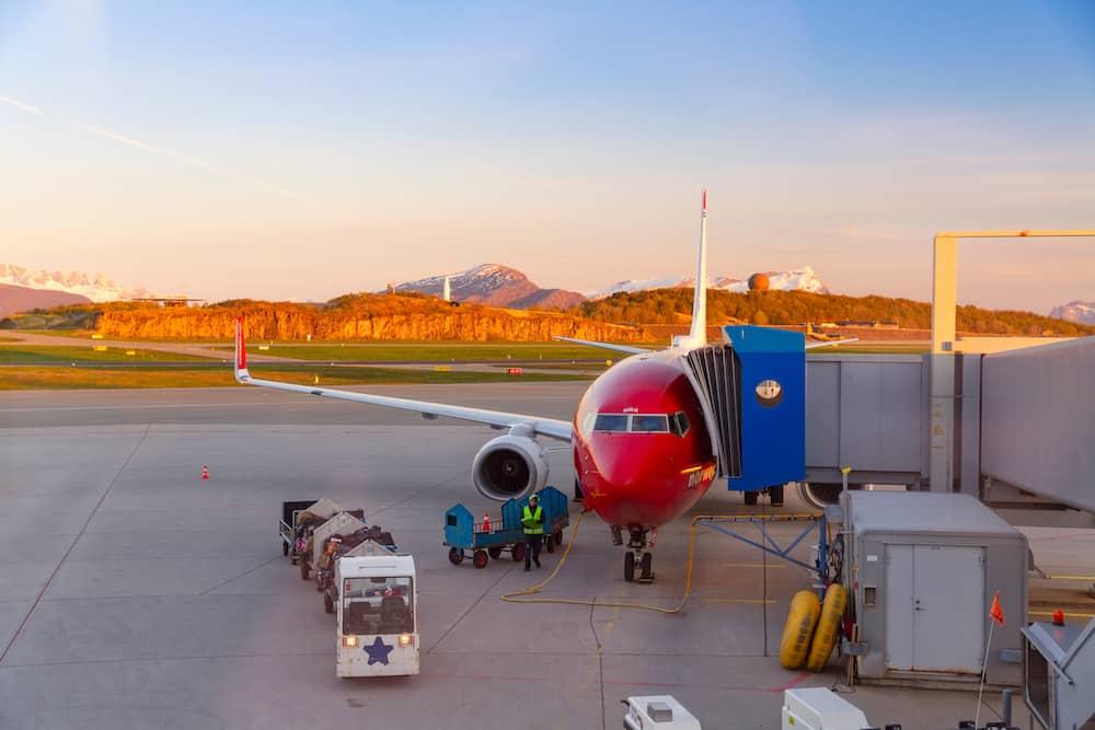 BODO, NORWAY - Norwegian Air Airplane At terminal Gate, during stop at Bodo, Norway. Bodo Airport, Midnight Sun Season.