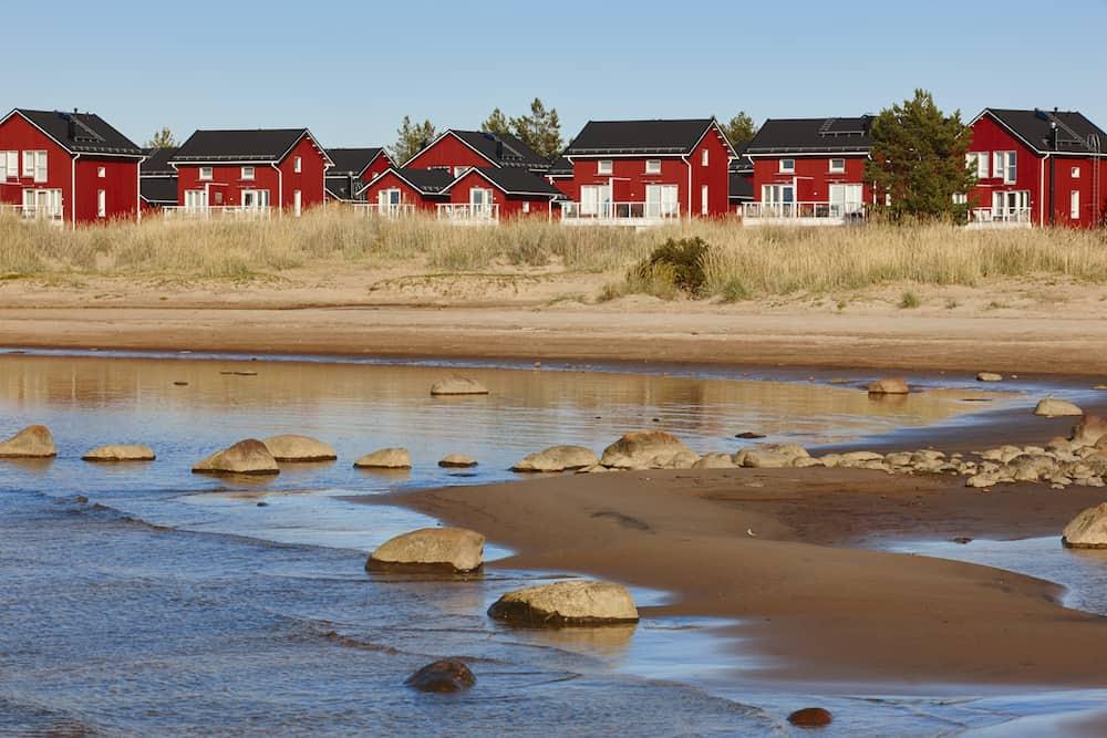 Red wooden houses near Marjaniemi beach Hailuoto island. Finland. Travel