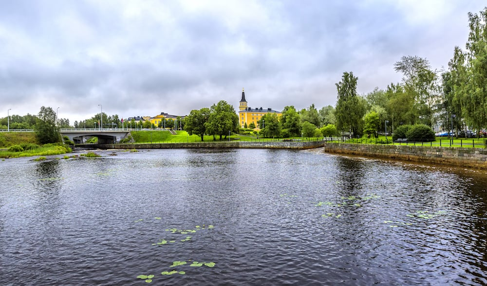 View on the Oulu Cathedral (Oulun tuomiokirkko) and Pokkisenvayla Bridge over Oulujoki river in Oulu.