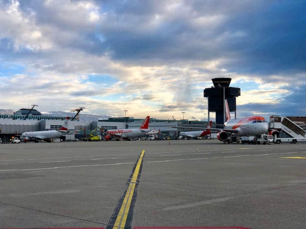 Parked commercial aircraft at Geneva Cointrin International Airport in Geneva, Switzerland.