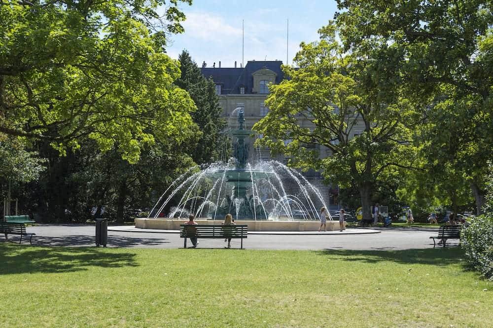 Geneva, Switzerland - a fountain plays in the Jardin Anglais in the centre of Geneva