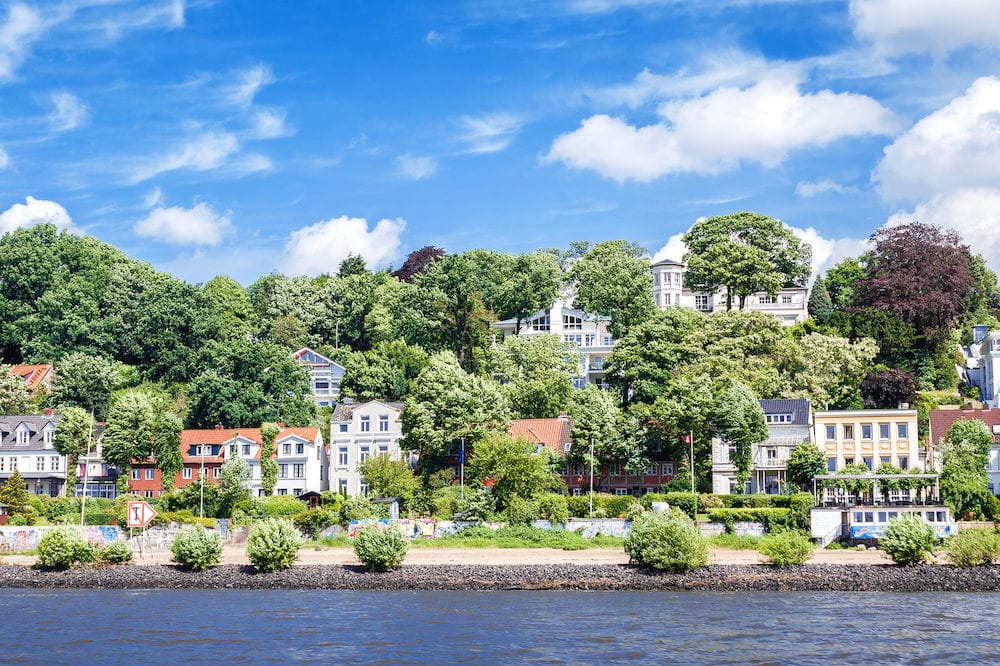 View from the Elbe to the luxury residential district of Hamburg Blankenese with small beach