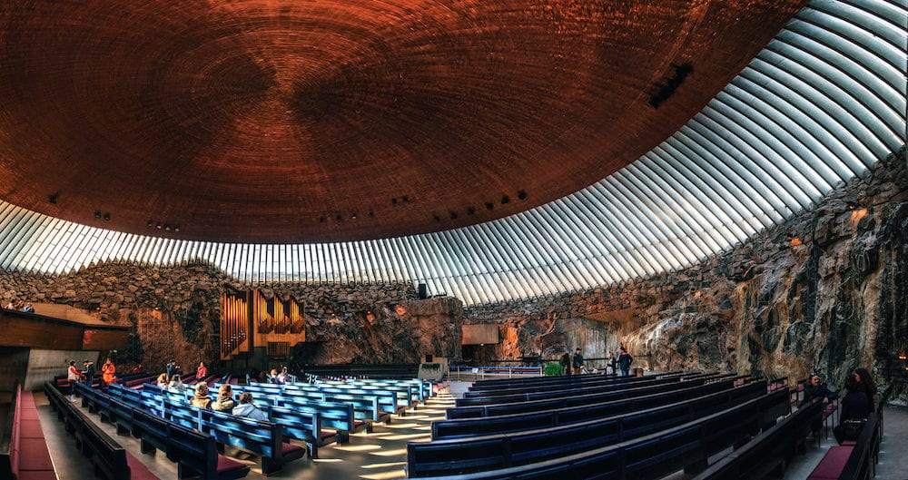 Helsinki Finland - Interior of the Rock Church Temppeliaukio Church with pipe organ and copper ceiling dome in the center of the Helsinki City Finland.