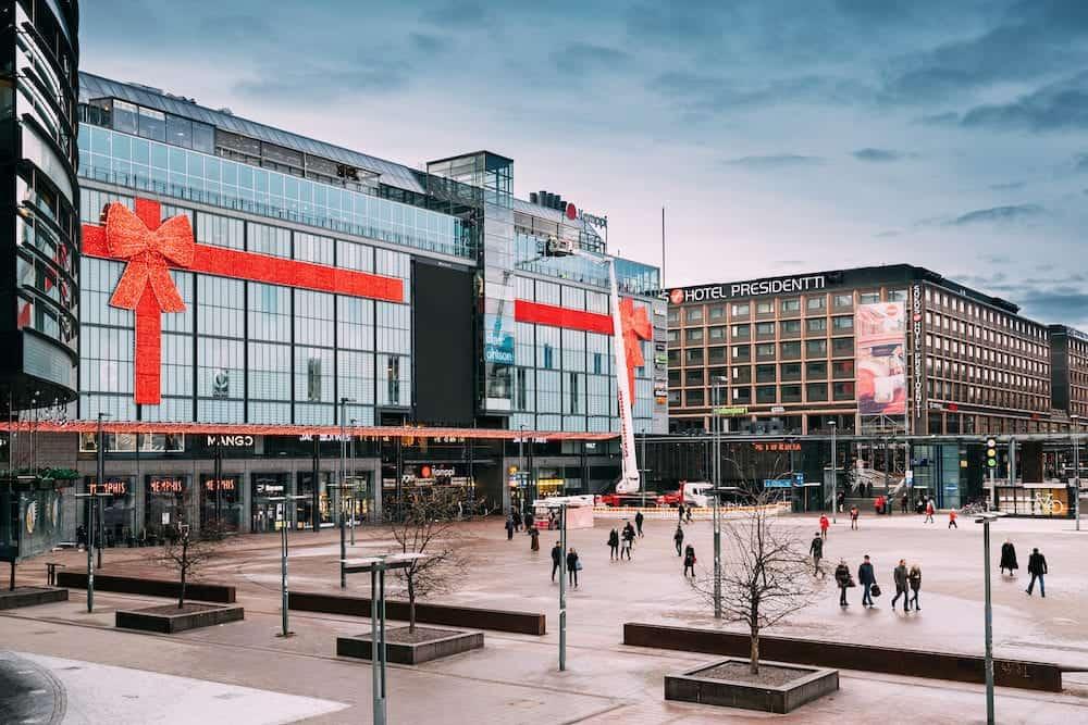 Helsinki, Finland - People Walking Near Original Sokos Hotel Presidentti And Kamppi Shopping Centre.