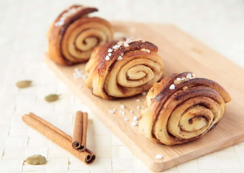 Three sweet rolls with cinnamon and cardamom