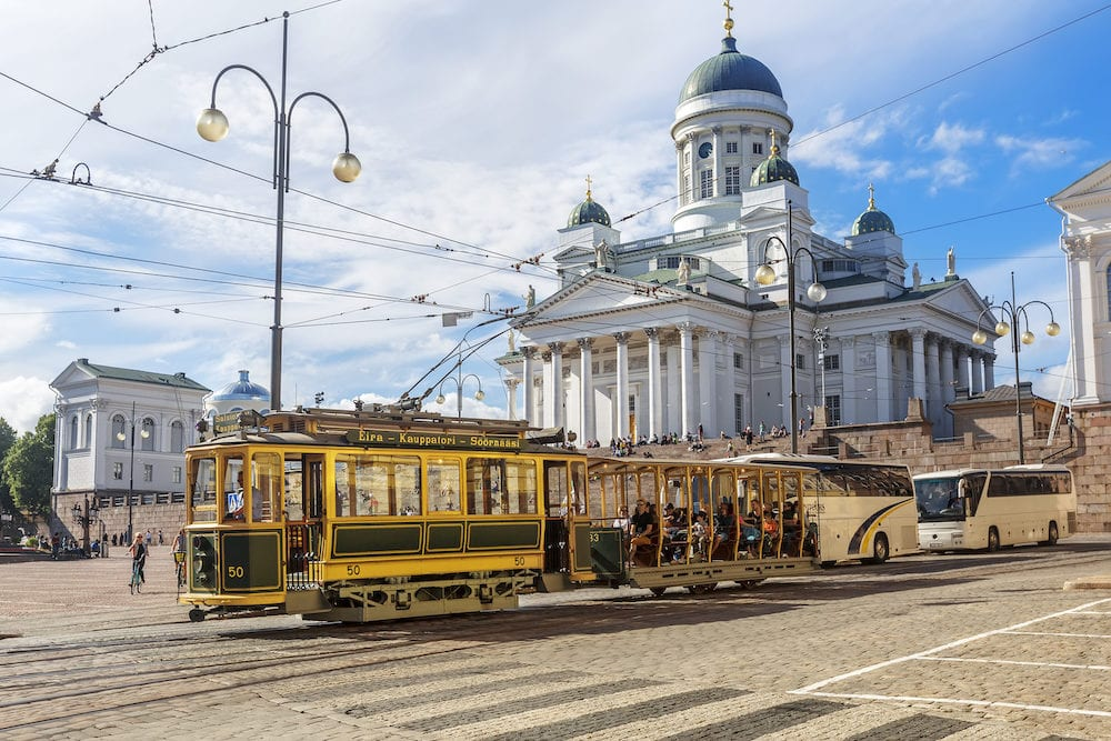 HELSINKI FINLAND - Tram passing by Helsinki Senate Square (Senaatintori) with Helsinki Cathedral in background. Helsinki.