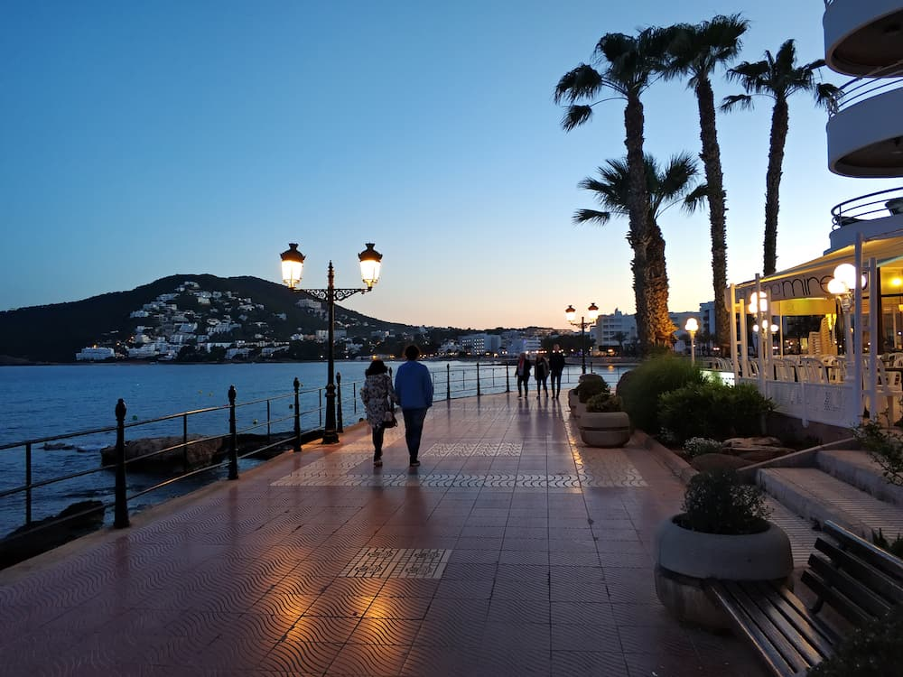 Ibiza Island, Spain - People walking by the seafront of Santa Eulalia. Santa Eulalia is a beautiful town and resort on the East coast of the Ibiza island