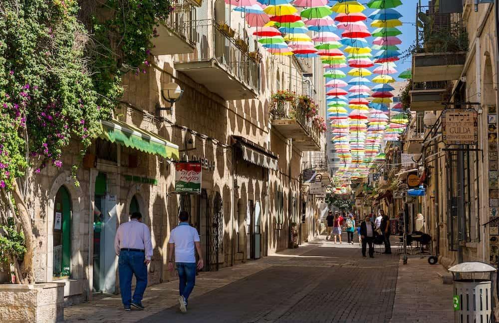 Jerusalem, Israel, - Multicolored umbrellas above the street Yoel Moshe Salomon in Jerusalem, district Nachalat Shiva.
